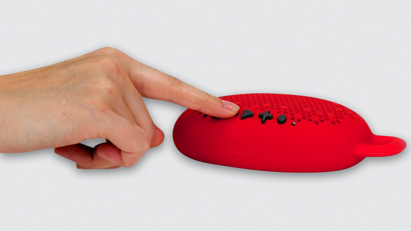 person engaging with Boom Urchin portable bluetooth speaker